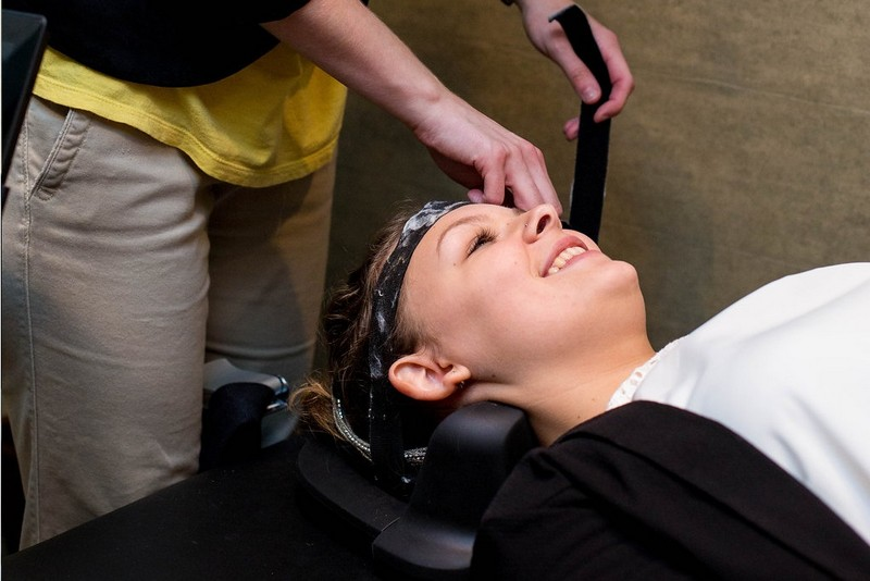 woman having Spinal Decompression on her head